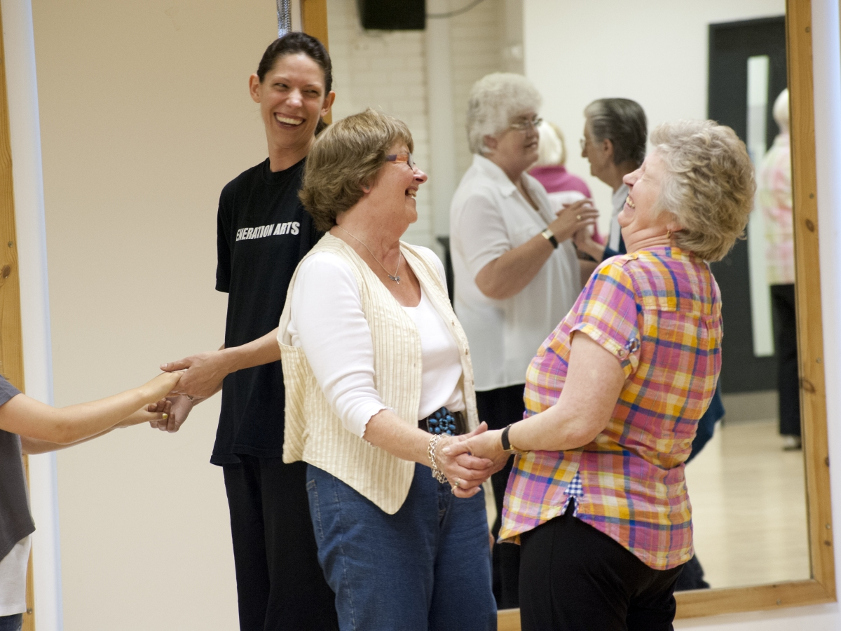 women dancing and laughing together